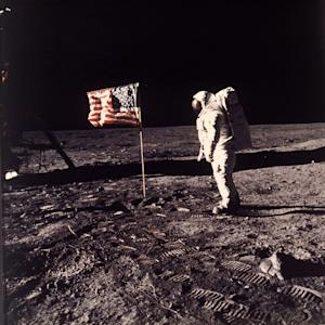 "FILE - In this July 20, 1969 file photo provided by NASA shows astronaut Edwin E. ""Buzz"" Aldrin Jr. posing for a photograph beside the U.S. flag deployed on the moon during the Apollo 11 mission. Aldrin and fellow astronaut Neil Armstrong were the first men to walk on the lunar surface. The trio was launched to the moon by a Saturn V launch vehicle at 9:32 a.m. EDT, July 16, 1969. They departed the moon July 21, 1969. (AP Photo/NASA, Neil Armstrong, File)"