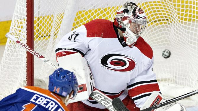 Edmonton Oilers' Jordan Eberle (14) scores on Carolina Hurricanes' Anton Khudobin (31) during the third period of an NHL hockey game Friday, Oct. 24, 2014, in Edmonton, Alberta. The Oilers won 6-3. (AP Photo/The Canadian Press, Jason Franson)