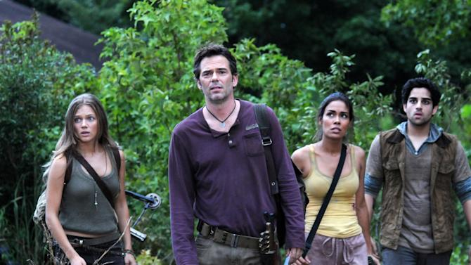 "FILE - This undated publicity image released by NBC shows, from left, Tracy Spiridakos as Charlie Matheson, Billy Burke as Miles Matheson, Daniella Alonso as Nora, and Paras Patel as Albert, in a scene from ""Revolution."" The series by J.J. Abrams tells of a world 15 years after the world inexplicably suffers a power outage. On Monday, Nov. 19, Led Zeppelin's ""Kashmir"" and ""Since I've Been Loving You"" will be featured in next week's episode, the same day, Led Zeppelin's ""Celebration Day"" album and a companion documentary on DVD will be released. (AP Photo/NBC, Brownie Harris, File)"
