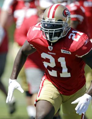 San Francisco 49ers running back Frank Gore (21) practices during NFL football training camp Tuesday, Aug. 2, 2011, in Santa Clara, Calif. The two-time Pro Bowl player practiced for the first time after missing the first four days of camp in a holdout. (AP Photo/Paul Sakuma)