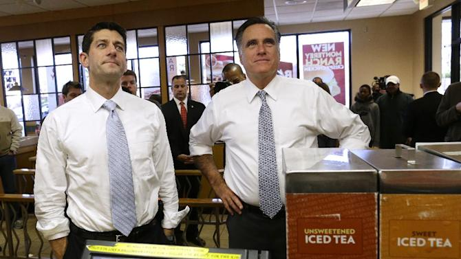 Republican presidential candidate, former Massachusetts Gov. Mitt Romney and his vice presidential running mate, Rep. Paul Ryan, R-Wis., get ready to order as they make an unscheduled stop at a Wendy's restaurant in Richmond Heights, Ohio, on Election Day, Tuesday, Nov. 6, 2012. (AP Photo/Charles Dharapak)