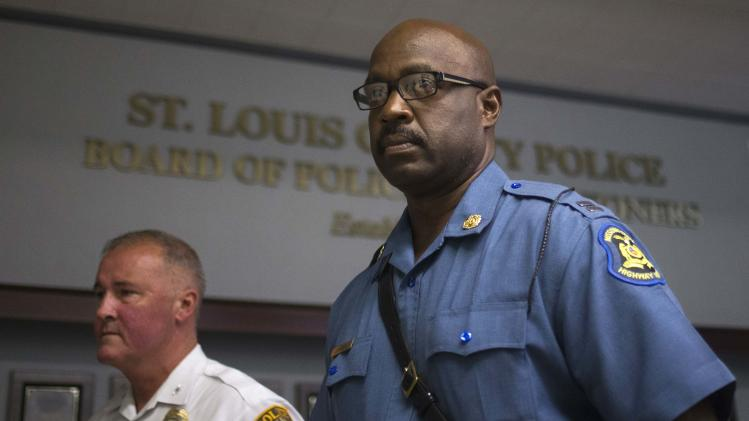 Missouri State Highway Patrol Captain Ron Johnson and St. Louis County Police Department Chief Jon Belmar are photographed after giving a news conference in St. Louis