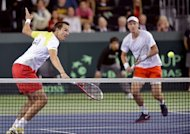 Tomas Berdych (R) and Lukas Rosol during their Davis Cup match against Stanislas Wawrinka and Marco Chiudinelli on February 2, 2013. Berdych and Rosol won 6-4, 5-7, 6-4, 6-7 (3/7), 24-22 in the longest Davis Cup clash of all time
