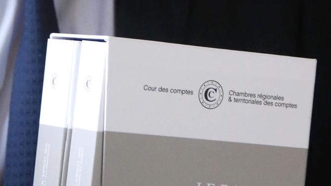 "The 2016 annual report of the Court of Auditors or ""Cour des Comptes"" is displayed during a news conference in Paris"