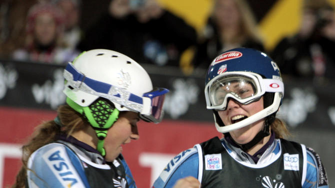 Mikaela Shiffrin, of the United States, right, celebrates with her teammate Resi Stiegler after winning an alpine ski, women's World Cup slalom, in Zagreb, Croatia, Friday, Jan. 4, 2013. (AP Photo/Marco Tacca)