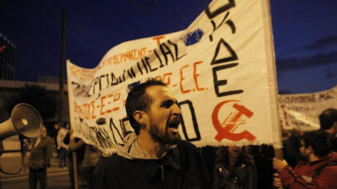 A protester shouts slogans during a rally in Athens on Saturday, Nov. 17, 2012. Several thousand marchers are commemorating the 39th anniversary of a deadly student uprising against the then ruling dictatorship, with more than 6,000 police deployed in the center of the Greek capital. (AP Photo/Kostas Tsironis)