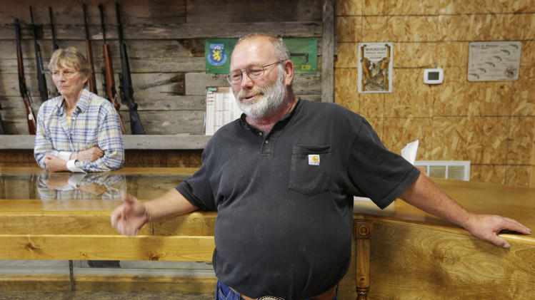 Jim and Arlena Sowash stand in their gun shop near Stover, Mo., Thursday, June 20, 2013. The pair signed a letter to Missouri Gov. Jay Nixon urging him to sign a bill nullifying federal gun laws. (AP Photo/Orlin Wagner)