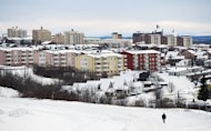 A lone man trudges through the snow on November 16, 2012 in Kiruna, northern Sweden. At the turn of the 19th century the area consisted of a handful of ramshackle buildings and traditional &quot;lavoo&quot;, the dwellings of the indigenous Sami population that are similar to the teepee used by American Indians
