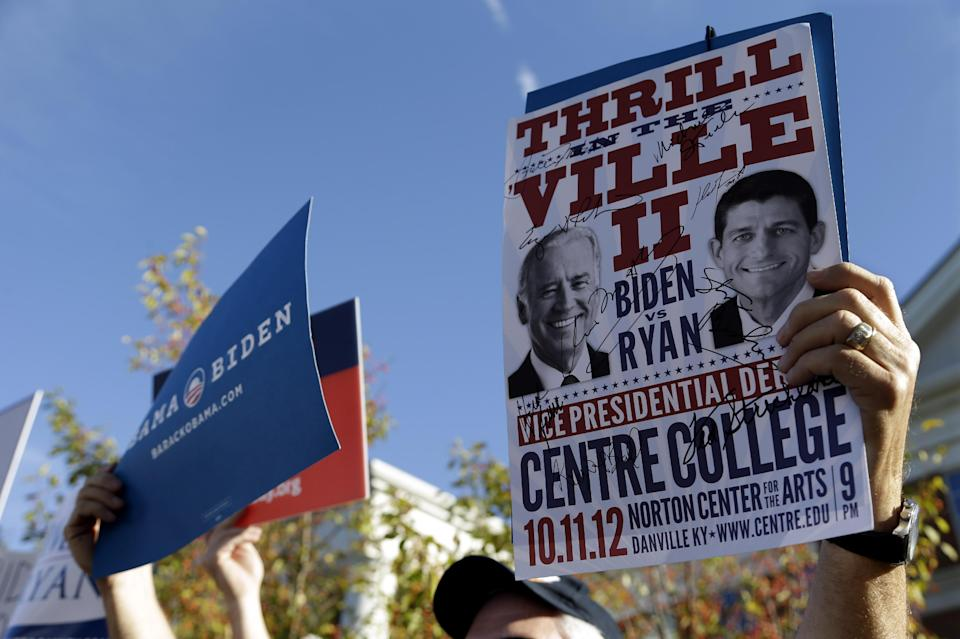 A sign promoting the Vice Presidential debate is held up at a rally on the Centre College campus, site of the debate, Thursday, Oct. 11, 2012, in Danville, Ky. Vice President Joe Biden will face Republican vice presidential candidate, Rep. Paul Ryan, R-Wis. (AP Photo/Eric Gay)