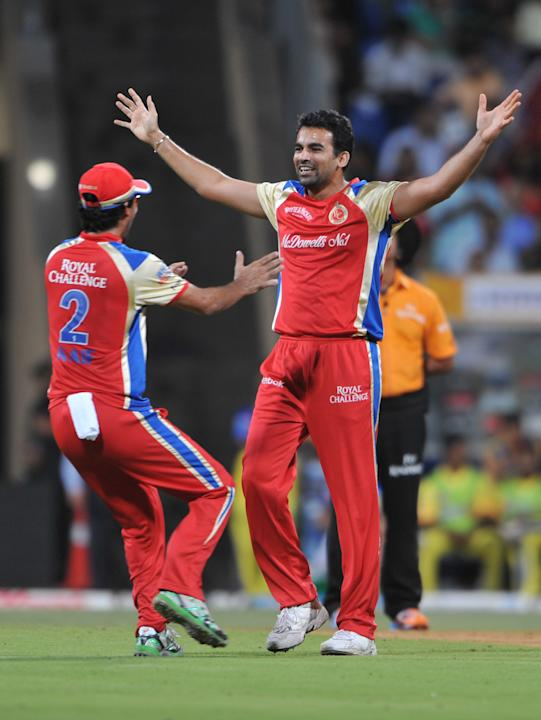 RESTRICTED TO EDITORIAL USE. MOBILE USE WITHIN NEWS PACKAGE  Royal Challengers Bangalore bowler Zaheer Khan (R) celebrates with his team mate after he dismissed Chennai Super Kings batsman Michael Hus