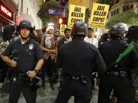 Protesters face off against police before being detained during a march in Los Angeles, California