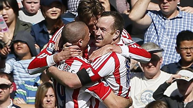 Stoke City's Peter Crouch (C) celebrates with team mates after scoring against Queens Park Rangers during their English Premier League soccer match at Loftus Road in London April 20, 2013 (Reuters)