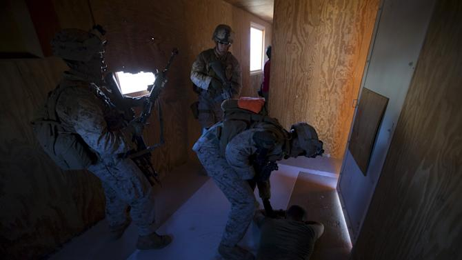 U.S. Marines from Fox Company, 2nd Battalion 1st Marines, 13th Marine Expeditionary Unit detain an insurgent during a non-live fire MOUT training at US Marine Corps: Marines Air Ground Combat Center in Twentynine Palms