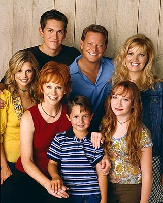 Clockwise from left: Joanna Garcia, Reba McEntire, Mitch Holleman, Scarlett Pomers, Melissa Peterman, Christopher Rich and Steve Howey The WB's Reba