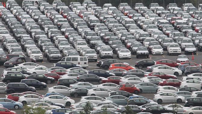 This June 25, 2012 photo shows cars parked at the Toyota auto terminal at the Port of Portland, in Portland, Ore. Chrysler, Volkswagen and Nissan all reported double-digit growth for July, and analysts predicted strong sales from Honda and Toyota would lead to overall industry growth of 11 percent. (AP Photo/Rick Bowmer)