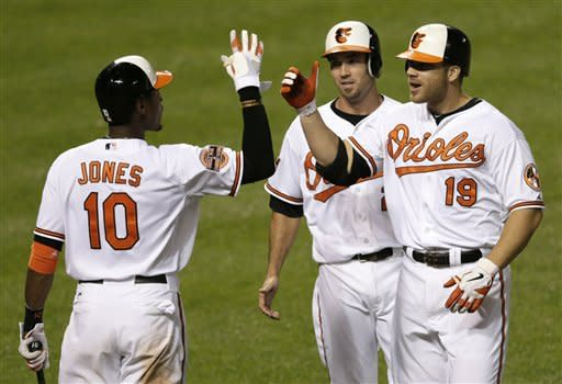 Arrieta works 7 innings as Orioles top Pirates 7-1