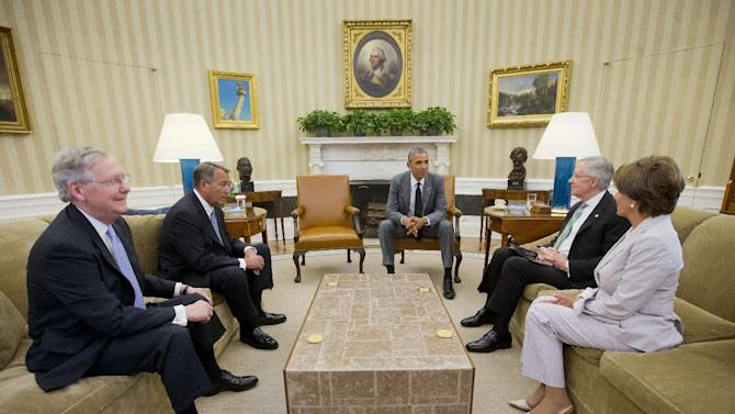 President Barack Obama meets with, from left, Senate Minority Leader Mitch McConnell of Ky., House Speaker John Boehner of Ohio, Senate Majority Leader Harry Reid of Nev., and House Minority Leader Nancy Pelosi of Calif., in the Oval Office of the White House in Washington, Wednesday, June 18, 2014. Obama briefed leaders of Congress on US options for blunting an Islamic insurgency in Iraq. US officials say Obama is not yet prepared to move forward with strikes and is instead focused on increased training for Iraq's security forces, boosting Iraqi intelligence capacities and upgrading equipment. (AP Photo/Pablo Martinez Monsivais)