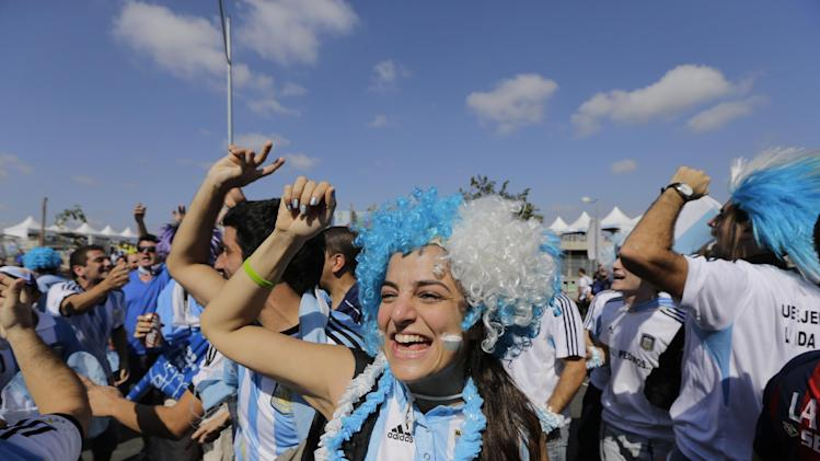 Argentine fans cheers as they arrive to attend  the group F World Cup soccer match between Argentina and Iran at the Mineirao Stadium in Belo Horizonte, Brazil, Saturday, June 21, 2014