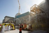 A handout picture shows a drill to control a fire and radioactive leak at a reactor at South Korea's Gori nuclear power plant in the southeastern county of Gijang