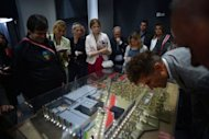 Journalists inspect a model of the Glavkino film studios located outside Moscow. The idea is to create a modern flagship studio that will make Russia a competitively priced destination for film projects and in turn modernise the local industry