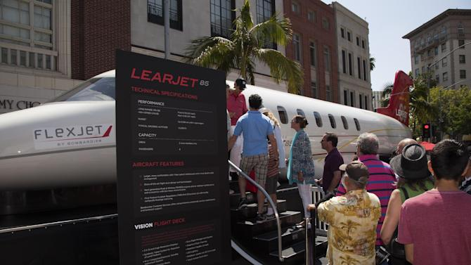 IMAGE DISTRIBUTED FOR FLEXJET - In honor of the 50th anniversary of Learjet, Flexjet - one of the world's most exclusive private jet companies - and Bombardier - the world's largest manufacturer of business aircraft- present the Learjet 85 aircraft fuselage as the first ever jet to take to the famous street during the annual Rodeo Drive Concours d'Elegance. Designed from a clean sheet, the Learjet 85 aircraft is the first business jet built primarily from carbon composites and features the latest advances in aerodynamics, structures and efficiency for a class that is truly its own. Fractional shares are available now exclusively through Flexjet. For more information, visit flexjet.com. (Jason Tinacci for Flexjet via AP Images)