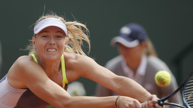 Russia's Maria Sharapova returns the ball to China's Jie Zheng during their third round match of the French Open tennis tournament at the Roland Garros stadium Saturday, June 1, 2013 in Paris. Sharapova won 6-1, 7-5. (AP Photo/Michel Spingler)