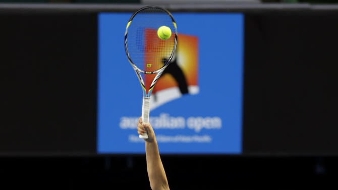 Victoria Azarenka of Belarus serves during a training session ahead of the Australian Open tennis championship in Melbourne, Australia, Sunday, Jan. 13, 2013. (AP Photo/Andy Wong)