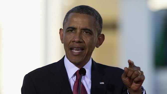 President Barack Obama gestures white speaking during a news conference with Tanzanian President Jakaya Kikwete at the State House in Dar Es Salaam, Tanzania, Monday, July 1, 2013. The president is traveling in Tanzania on the final leg of his three-country tour in Africa. (AP Photo/Evan Vucci)