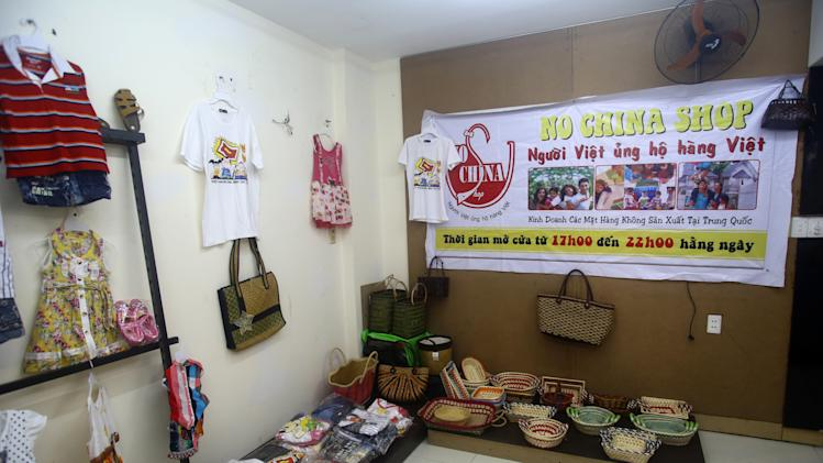 """This March 14, 2013 photo shows a corner inside the """"No China Shop"""", which sells only goods made in Vietnam - children's clothes, shoes and vegetables- and offers to source others in Ho Chi Minh City. The shop was opened in Dec. 2013 by Paulo Thanh Nguyen in Ho Chi Minh city, Vietnam. His decision to launch the business was as much about harnessing and spreading anger against China as it was about making money. (AP Photo/Na Son Nguyen)"""