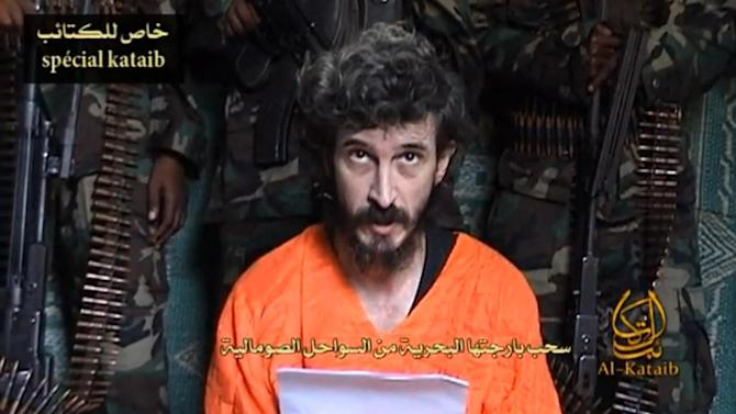 FILE- In this undated file image from a video posted on islamic militant websites  and made available Wednesday June 9 2010, a man identified as French security agent Denis Allex pleads for his release from the Somali militant group al-Shabaab who have been holding him for nearly a year. Somalia's most dangerous militant group said Thursday, Jan. 17, 2013 that it killed Allex, whom French military forces tried to rescue last weekend during a botched raid. Al-Shabab said in a Twitter posting that the kidnapped intelligence agent, codenamed Denis Allex, was executed Wednesday evening, Jan. 16, 2013 Somalia time. French officials have said they believe Allex was killed the night of the raid and that claims by al-Shabab of an impending execution were propaganda. (AP Photo, File)