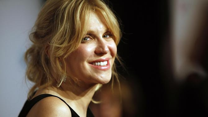 """FILE - In this Oct. 15, 2013 file photo, Courtney Love arrives at the Elton John AIDS Foundation's 12th Annual """"An Enduring Vision"""" benefit gala at Cipriani Wall Street, in New York. A jury determined Friday, Jan. 24, 2014, that Love did not defame a San Diego attorney when she sent a 2010 tweet stating that the lawyer had been """"bought off."""" Attorneys for Rhonda Holmes had been seeking $8 million in damages but the jury rejected her case. (Photo by Carlo Allegri/Invision/AP, file)"""