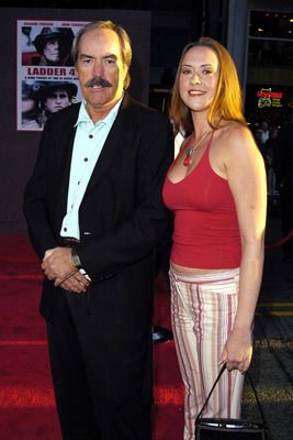 Premiere: Powers Boothe with his daughter at the Hollywood premiere of Touchstone Pictures' Ladder 49 - 9/20/2004