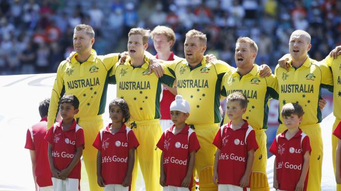 The Australian team sing the national anthem at Eden Park before their Cricket World Cup match against New Zealand in Auckland