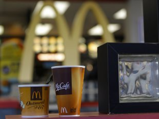 McDonald's sign and coffee cups: Credit Reuters
