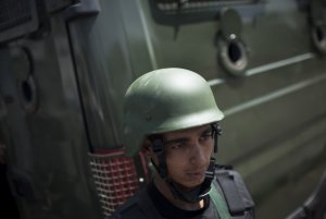 A member of Egyptian police special forces stands guard…