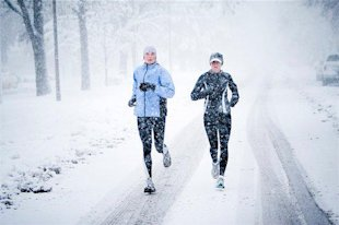 Women running in the snow