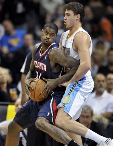 Nene's 22 points lifts Nuggets past Hawks in OT
