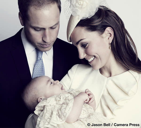 Britain's Prince William, his wife Catherine, Duchess of Cambridge and their son Prince George, pose for the official portrait in London