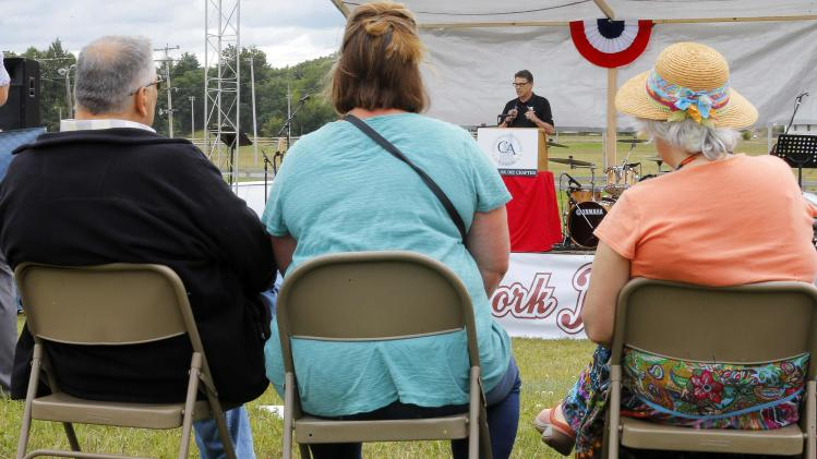 "Texas Governor Rick Perry, a possible Republican candidate for the 2016 presidential race, speaks at the Concerned Veterans for America ""Defend Freedom Pork Roast"" in Rochester"