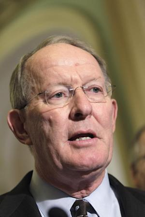 FILE - In this July 19, 2011 file photo, Sen. Lamar Alexander, R-Tenn., the number three Senate Republican leader, is seen on Capitol Hill in Washington. Alexander, chairman of the Senate Republican Conference for four years, said he will step down from his leadership post but remain in the Senate and run for re- election in 2014. (AP Photo/File/J. Scott Applewhite)
