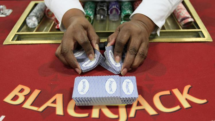 Mary Battle practices shuffling a deck of cards during a training session, Tuesday, Nov. 27, 2012, at Horseshoe Casino Cincinnati in Cincinnati. One of the safest bets at the new casino set to open this spring is that cheaters will be among the gamblers, targeting dealers who have only dealt cards in a training room. (AP Photo/Al Behrman)