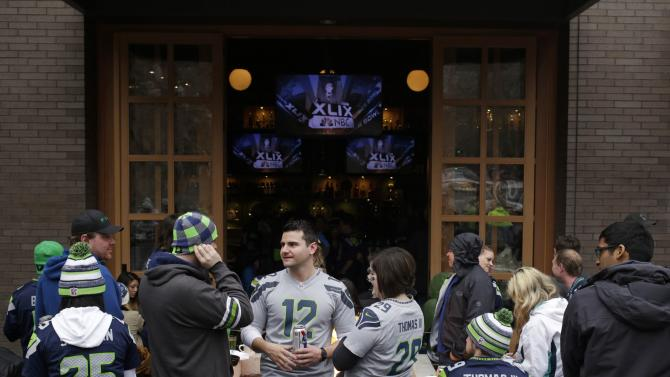 Seattle Seahawks fans gather to watch the Super Bowl XLIX, at a bar near CenturyLink Field in Seattle, Washington