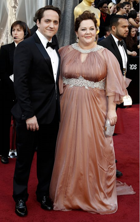 Ben Falcone, left, and Melissa McCarthy arrive before the 84th Academy Awards on Sunday, Feb. 26, 2012, in the Hollywood section of Los Angeles. (AP Photo/Matt Sayles)