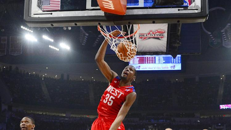West Team's Kevin Durant of the Oklahoma City Thunder dunks during the first half of the NBA All-Star basketball game Sunday, Feb. 17, 2013, in Houston. (AP Photo/Bob Donnan, Pool)