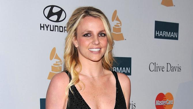 "FILE - In this Feb. 11, 2012 file photo, singer Britney Spears arrives at the Pre-GRAMMY Gala & Salute to Industry Icons with Clive Davis honoring Richard Branson in Beverly Hills, Calif. Testimony is scheduled to begin on Tuesday, Oct. 16, 2012, in a libel, defamation and breach of contract case filed against Spears and her parents by the singer's former confidante and manager, Osama ""Sam"" Lutfi. He is seeking a share of Spears' fortune and claims he has was unfairly vilified by the singer's mother in her 2008 book, which accused Lutfi of drugging and isolating the pop star before she had to be hospitalized. (AP Photo/Vince Bucci, file)"
