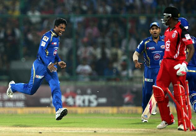 MI bowler Pragyan Ojha and captain Rohit Sharma celebrates fall of wicket during the 2nd CLT20 semi-final match between Mumbai Indians and Trinidad & Tobago at Feroz Shah Kotla, Delhi on Oct. 5, 2013.