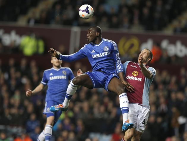 Chelsea's Ba is challenged by Aston Villa's Vlaar during their English Premier League soccer match at Villa Park in Birmingham