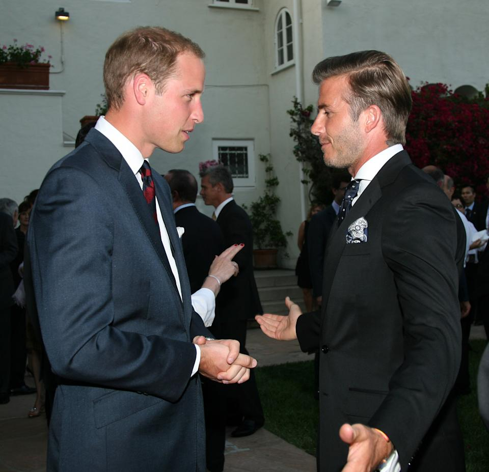 Prince William, Duke of Cambridge, left, mingles with David Beckham at a private reception at the British Consul-General's residence in Los Angeles, Friday, July 8, 2011. (AP Photo/Matt Baron, Pool)