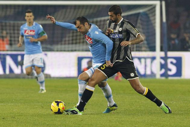 Napoli's Pandev is challenged by Udinese's Danilo during their Italian Serie A soccer match at San Paolo stadium in Naples