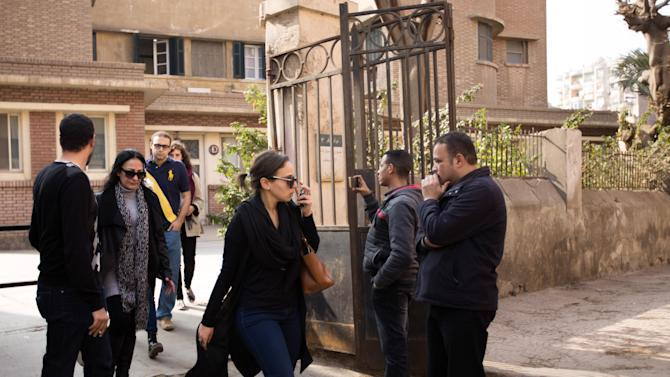Mourners leave the Italian Hospital in Cairo after a a private mass at the church in the hospital complex for slain Italian graduate student Giulio Regeni on Friday, Feb. 5, 2016. Regeni, a 28-year-old Cambridge University PhD candidate who had been researching labor rights in Egypt, went missing on Jan. 25, the fifth anniversary of the popular uprising that toppled longtime autocrat Hosni Mubarak. His body was found Wednesday bearing signs of torture. (AP Photo/Belal Darder)